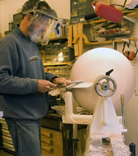 Joe Feinblatt turning lamp at lathe